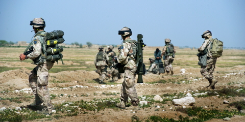 Swedish soldiers carry out a search of an area of Afghanistan.