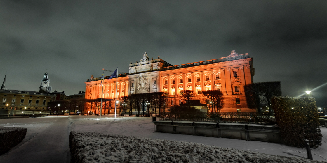 Light projected onto the main façade of the Riksdag building facing Norrbro