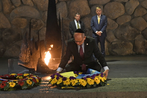 The Speaker laying a wreath to honour the victims of the Holocaust.